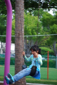 Park girl on swing for class